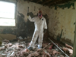 The happy homeowner in his freshly gutted bedroom.