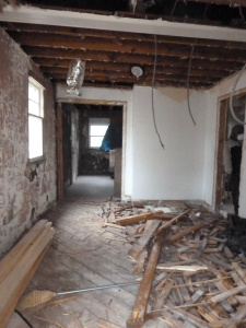 The gutted kitchen looking towards the living room.