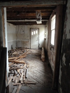 The gutted kitchen looking towards the side door.