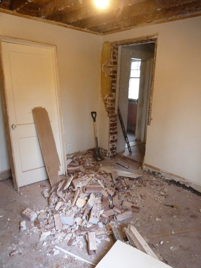 The original window was removed and a doorway was cut in the brick wall.