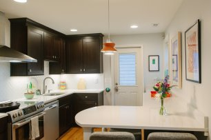 The kitchen includes Whirlpool range hood and Bosch cooking and dishwasher.