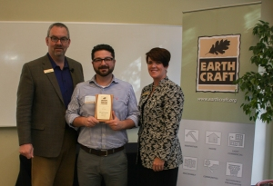 Abe Kruger receives the EarthCraft Design Award from Southface's Marci Reed and Robert Reed.